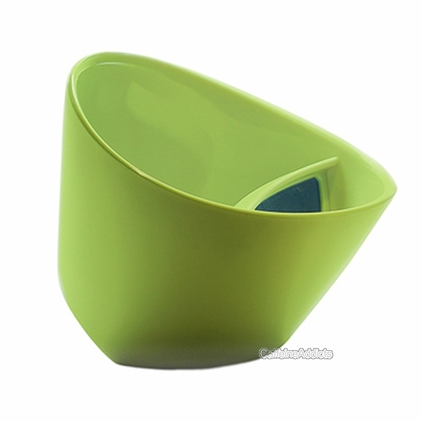 Tipping teacup side green